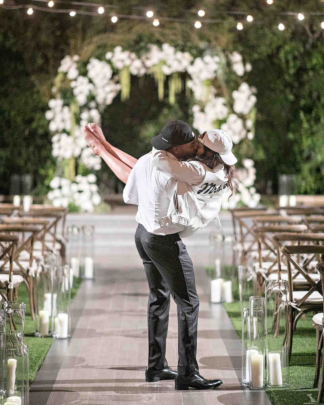 danielle kevin wedding couple kissing in hats