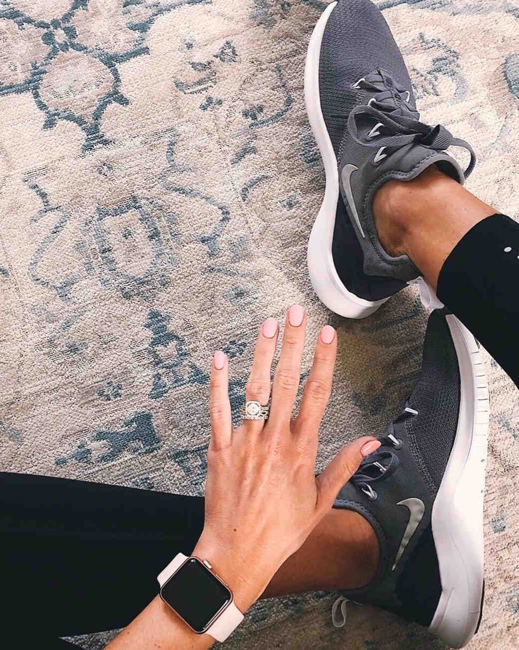 engagement ring selfie fitness attire