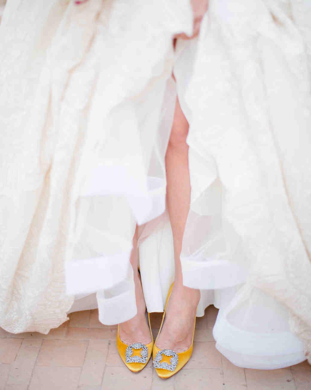 Yellow shoes under wedding dress