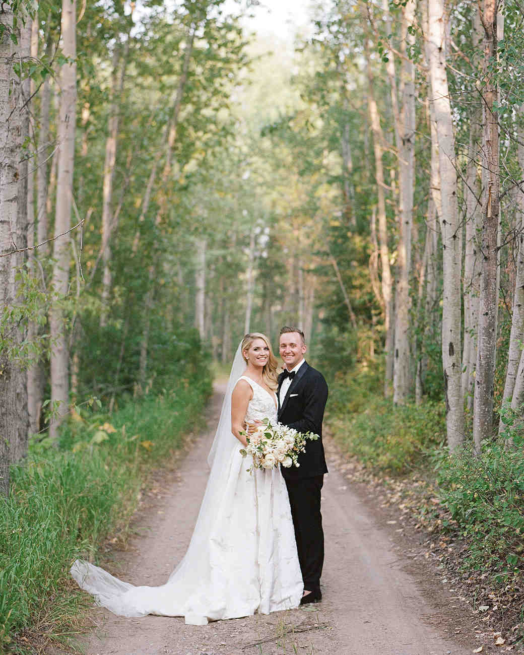kaitlin jeremy wedding couple on tree-lined path