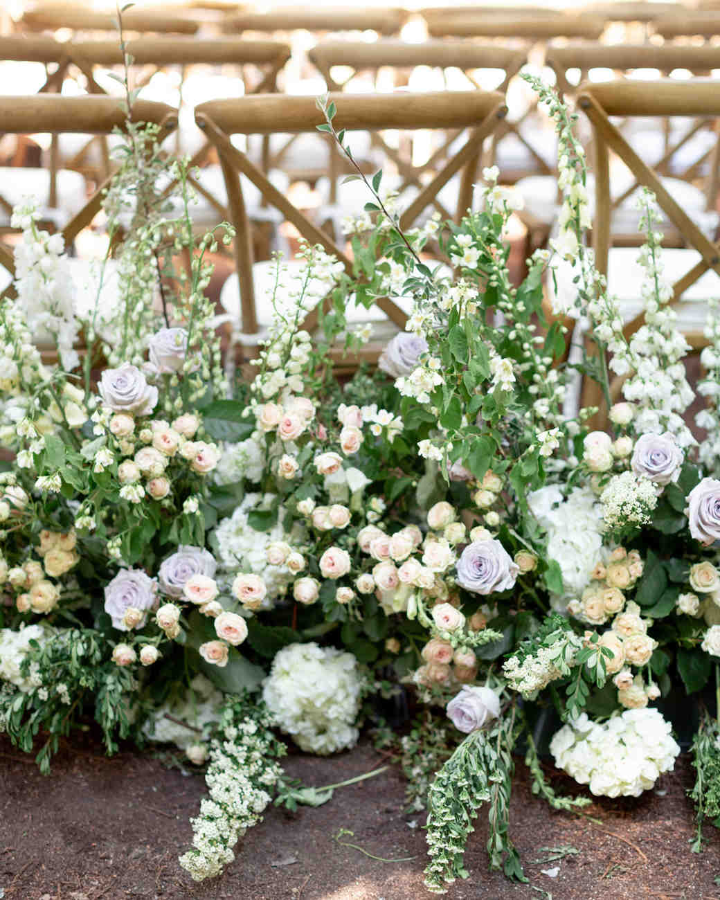 last row ceremony chair decorations roses hydrangeas and greenery