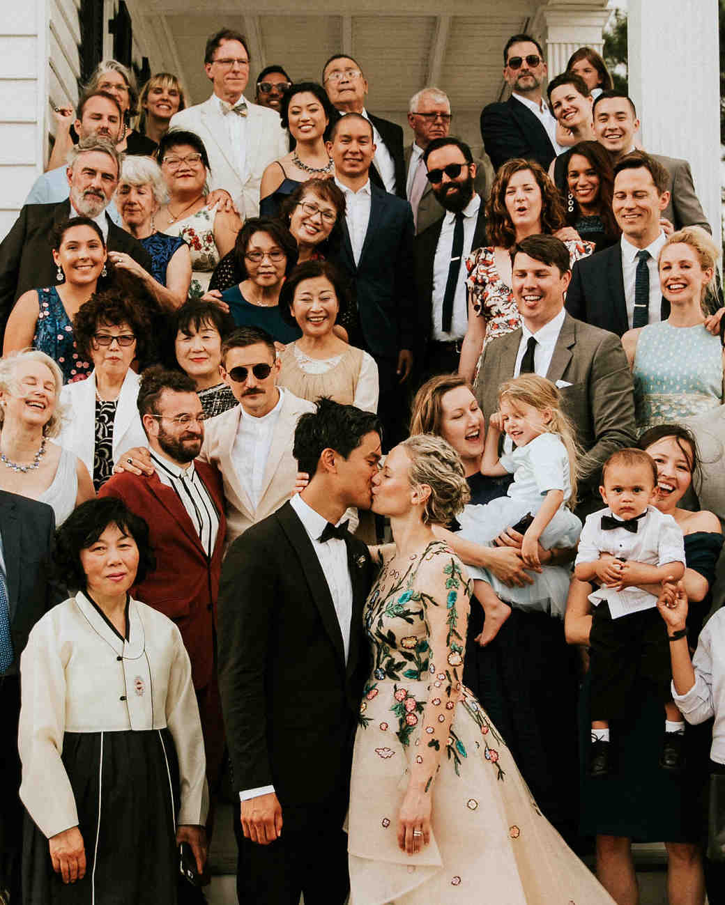 leah michael wedding group photo couple kiss