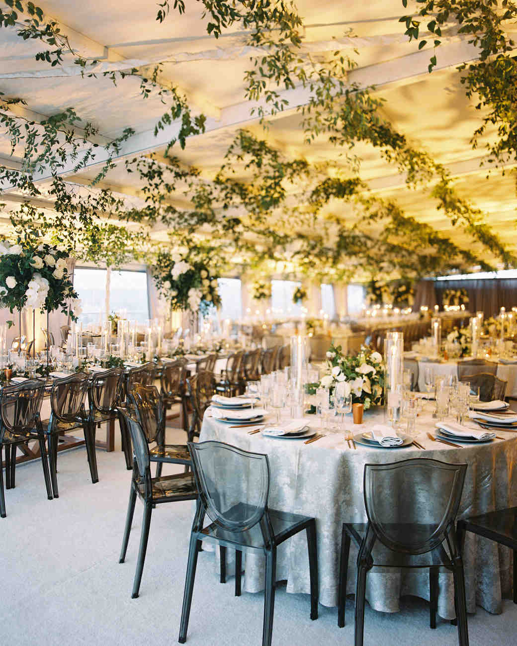 melissa justen wedding reception tables with hanging greenery