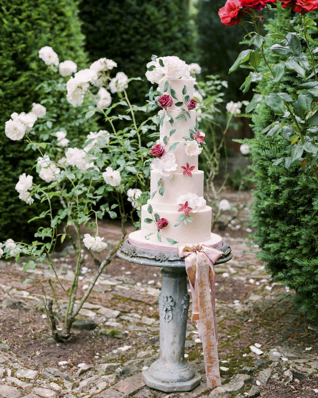 large pink wedding cake with flowers