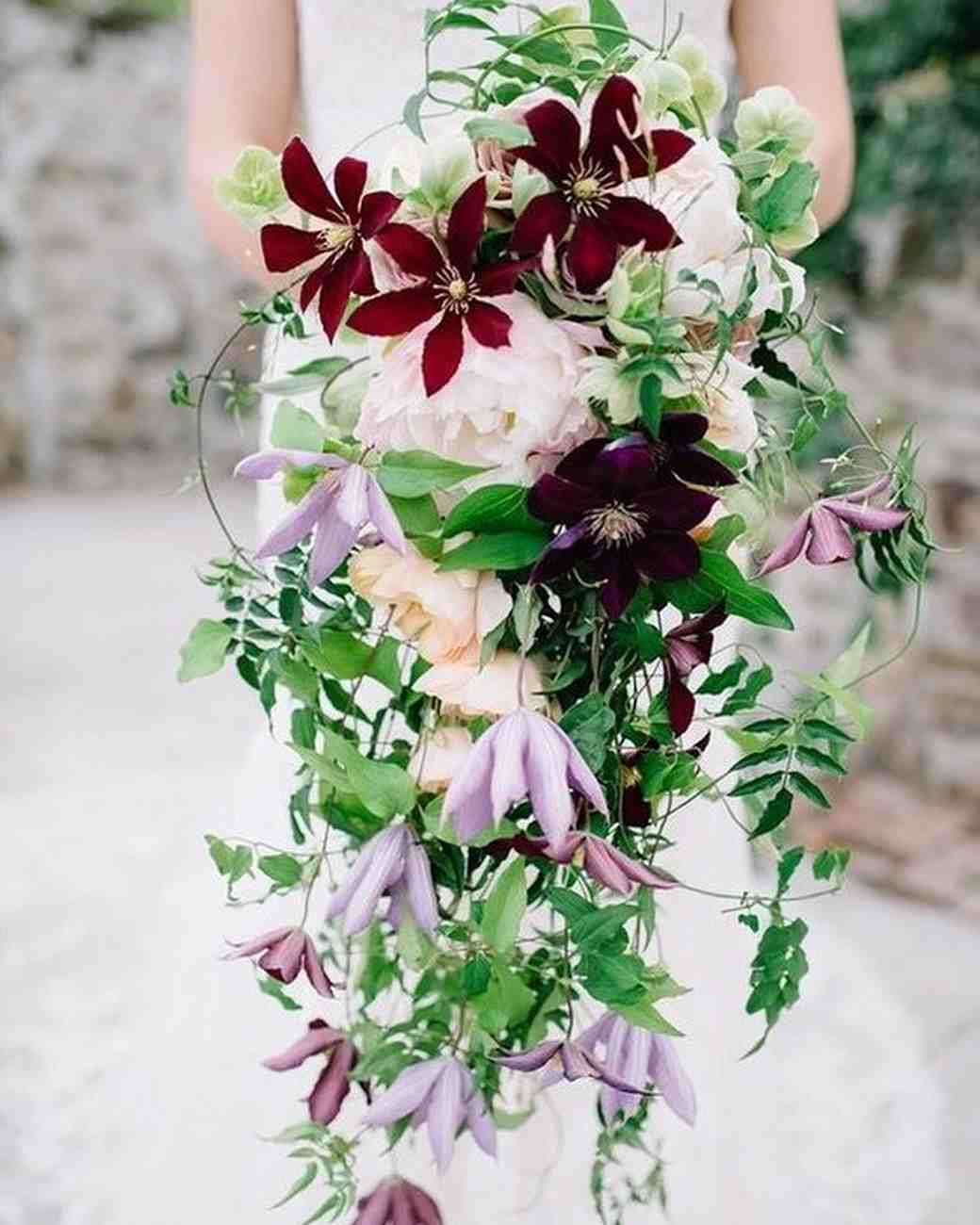cascade bouquet with peonies purple flowers