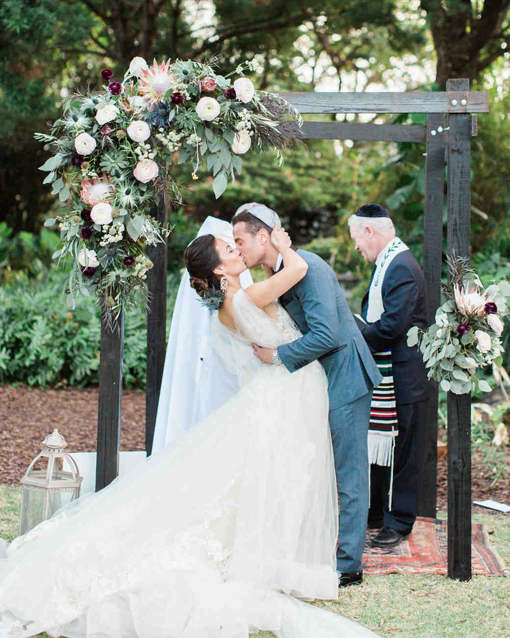 bride and groom kiss post ceremony