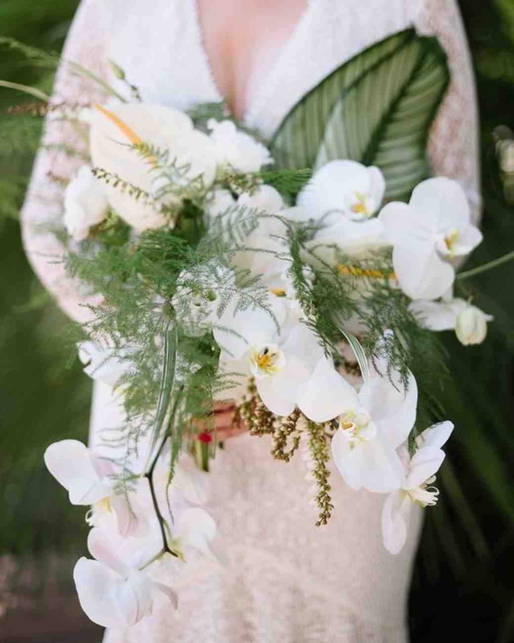 Chinese evergreens and orchids tropical leaf bouquet