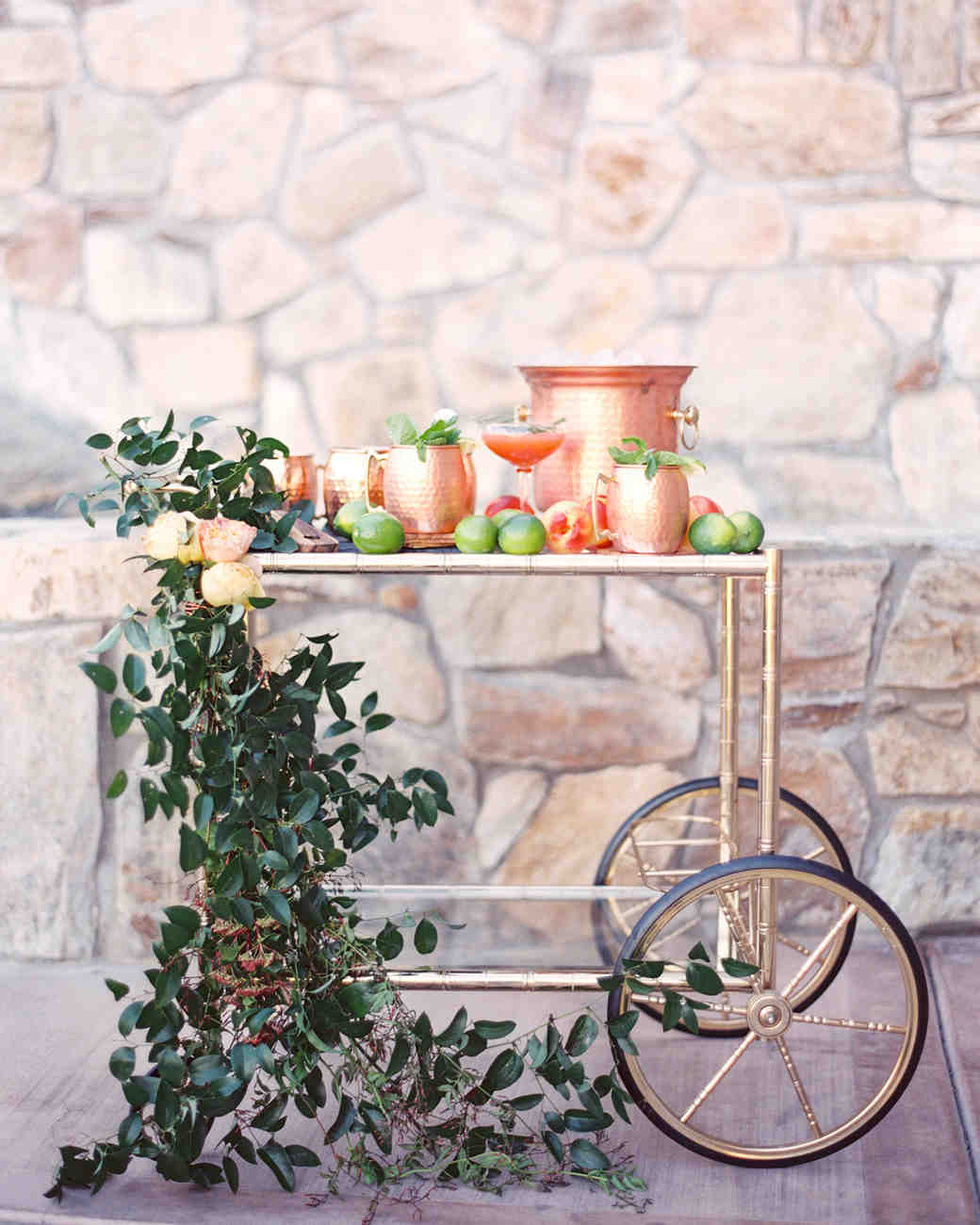fall wedding bar cart featuring apples and copper details