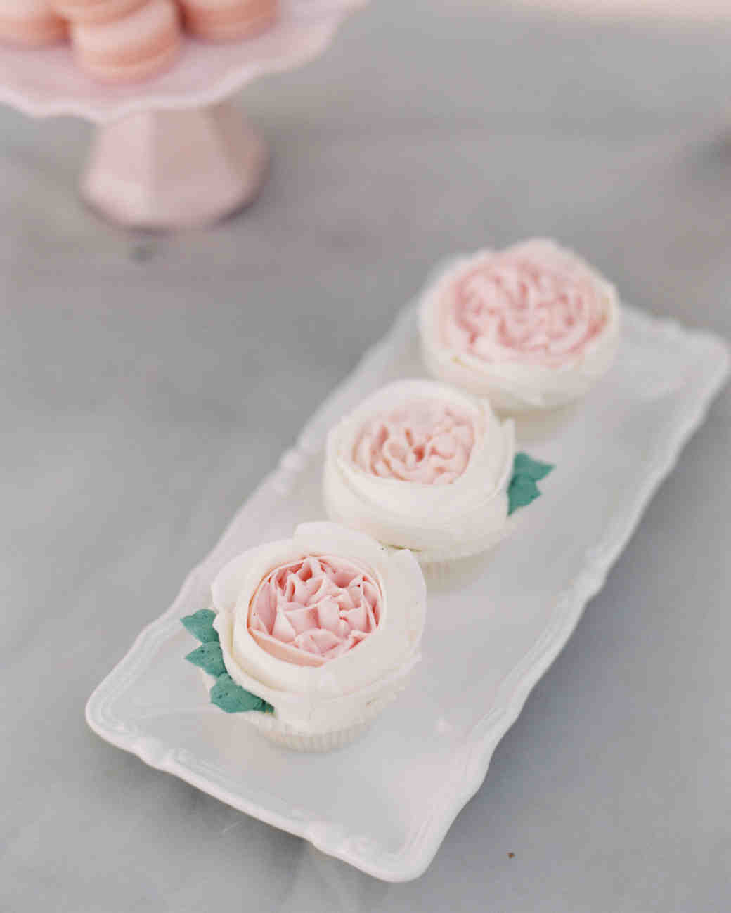 pink frosted cupcakes with roses