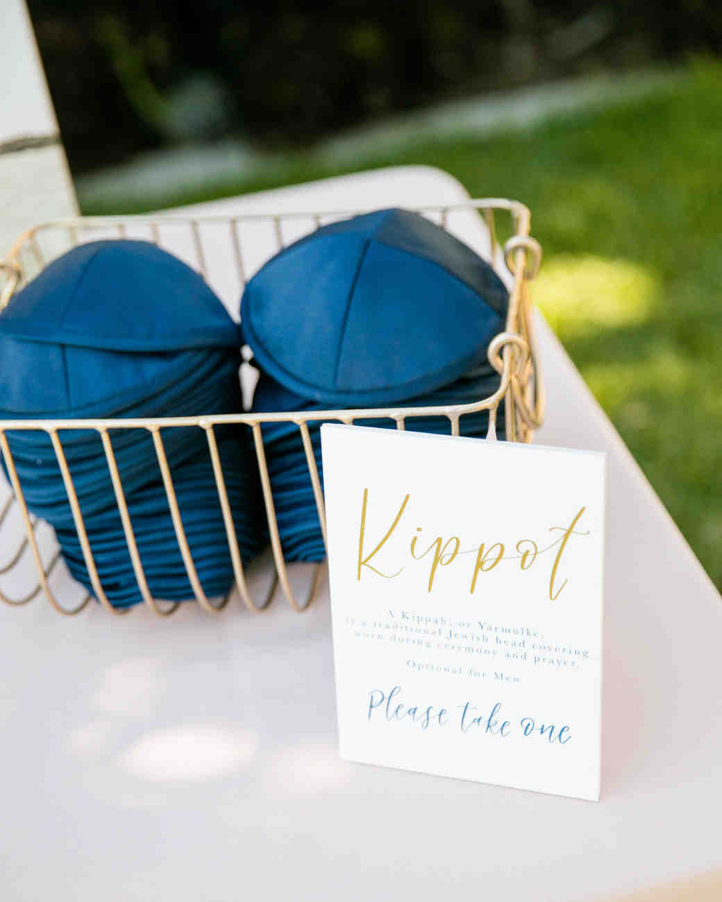 navy blue kippots with gold accent decor on table