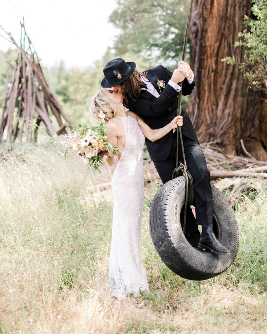 amanda chase wedding couple kissing on tire swing