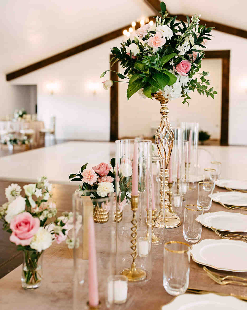 gold wedding reception table top with pink roses