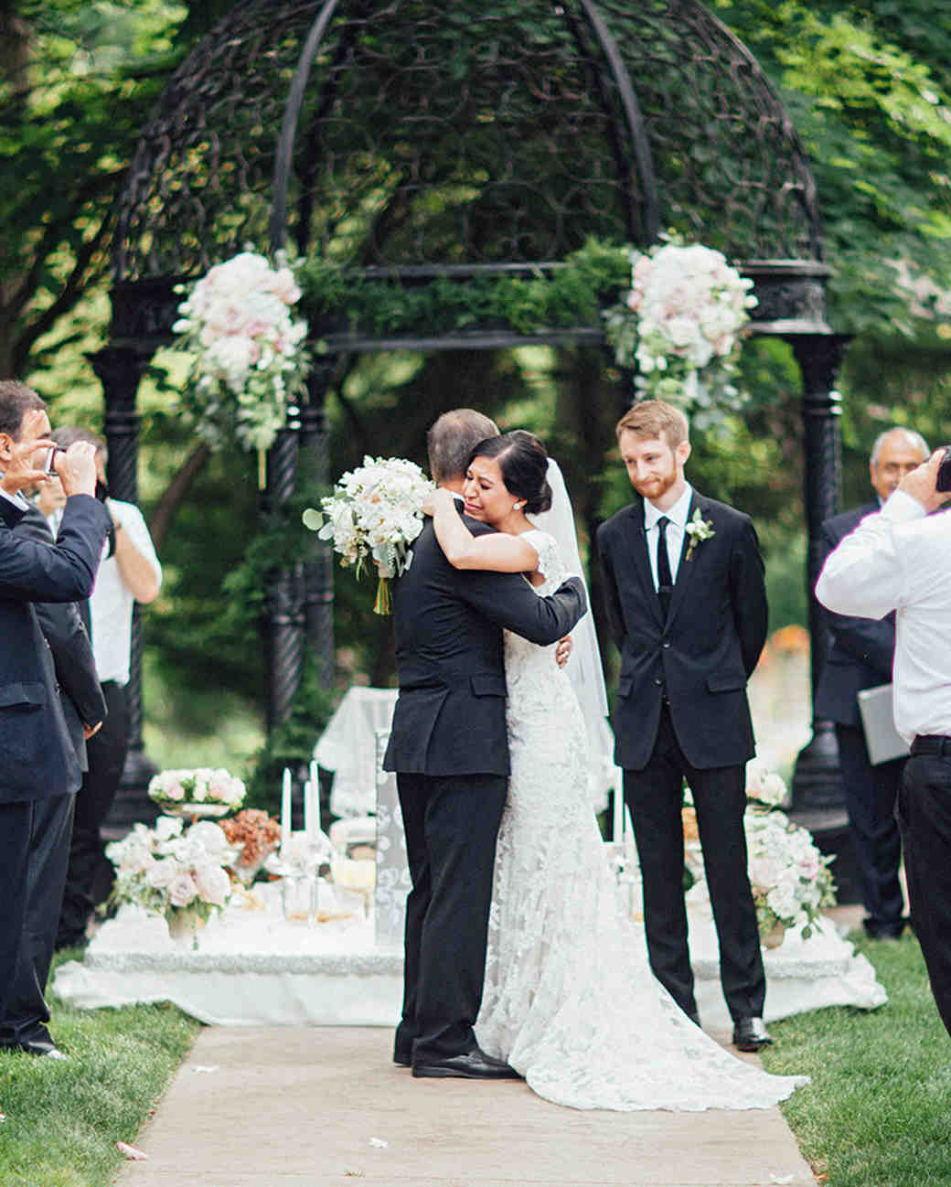 father and bride emotional hug at ceremony