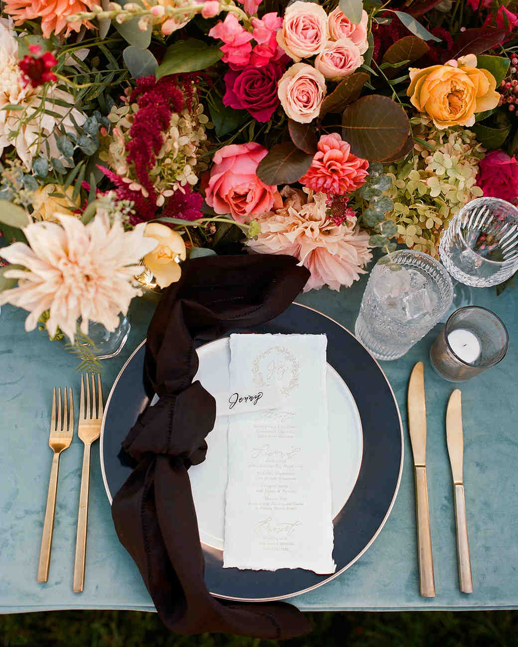 jen geoff wedding place setting and centerpiece