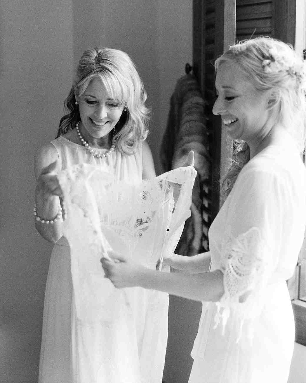 Mother and Daughter Holding a Wedding Dress