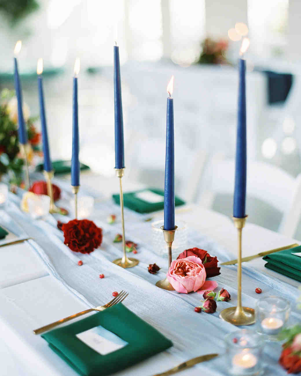 unique wedding color palettes dark green blue and pink candles table setting