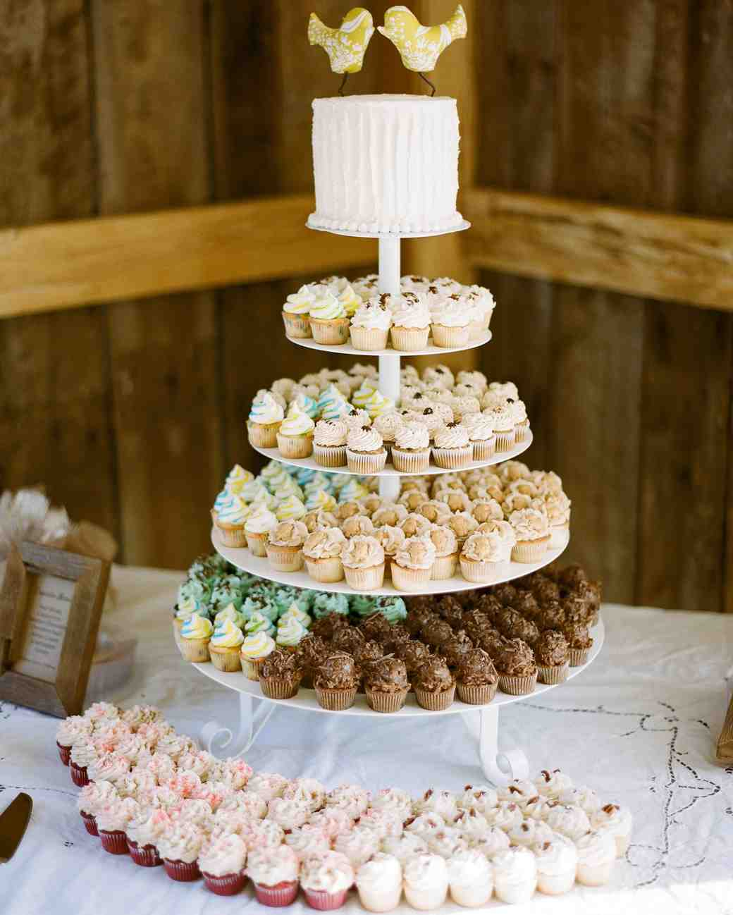 four tiered cupcake stand with multi-colored cupcakes