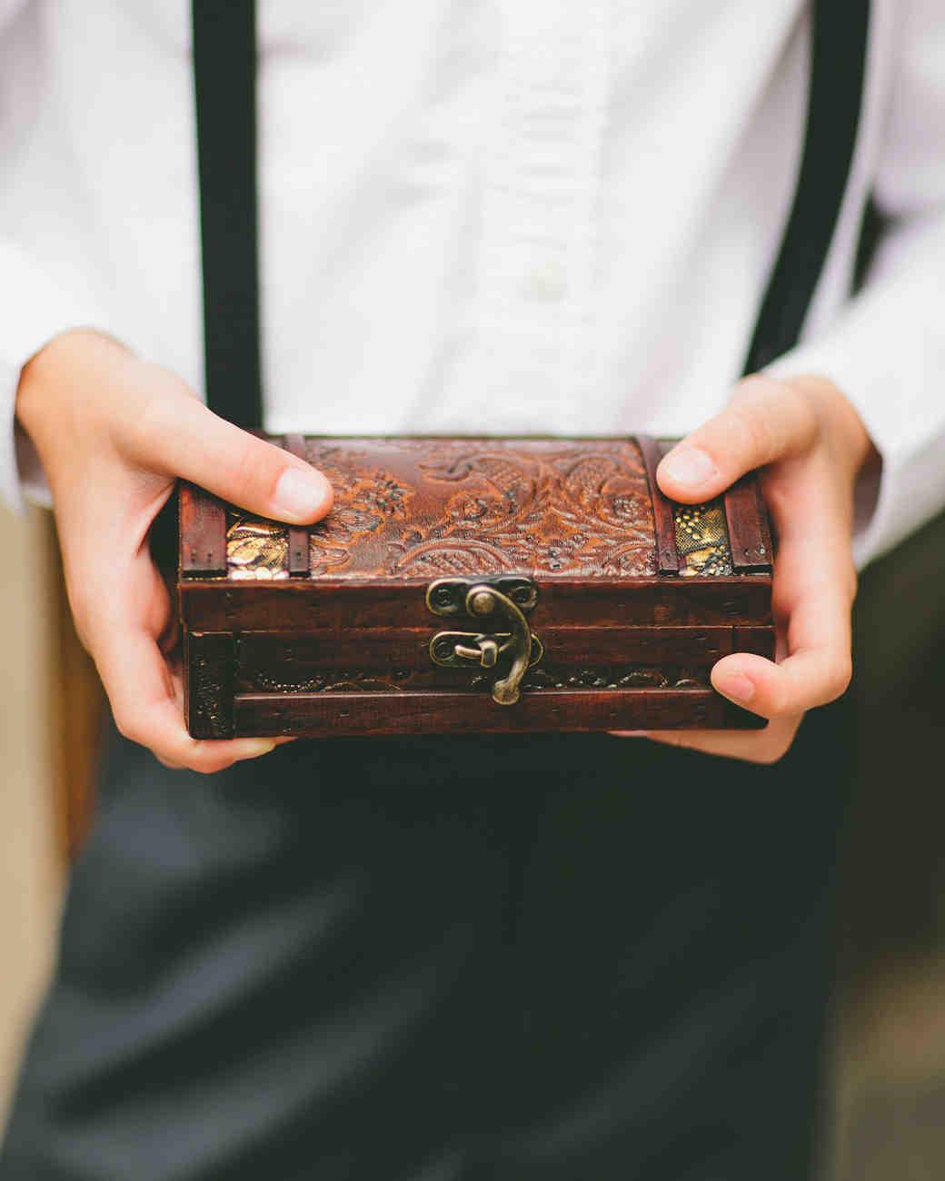 ring bearer holding ornate box at wedding