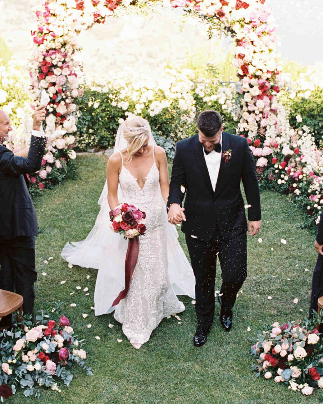 allie and joe italy wedding recessional guests tossing lavender and rose petals