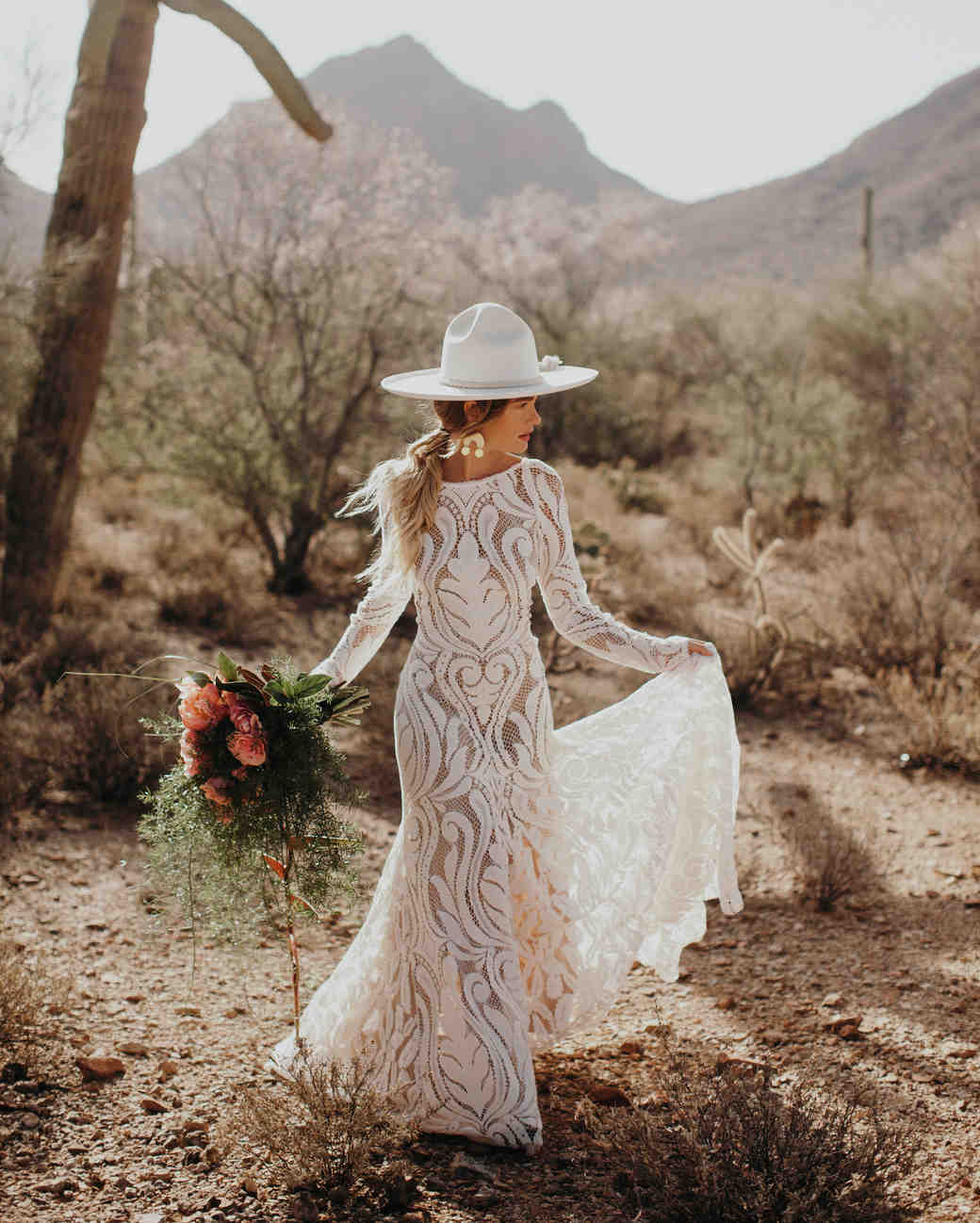 bride wearing white hat in the desert