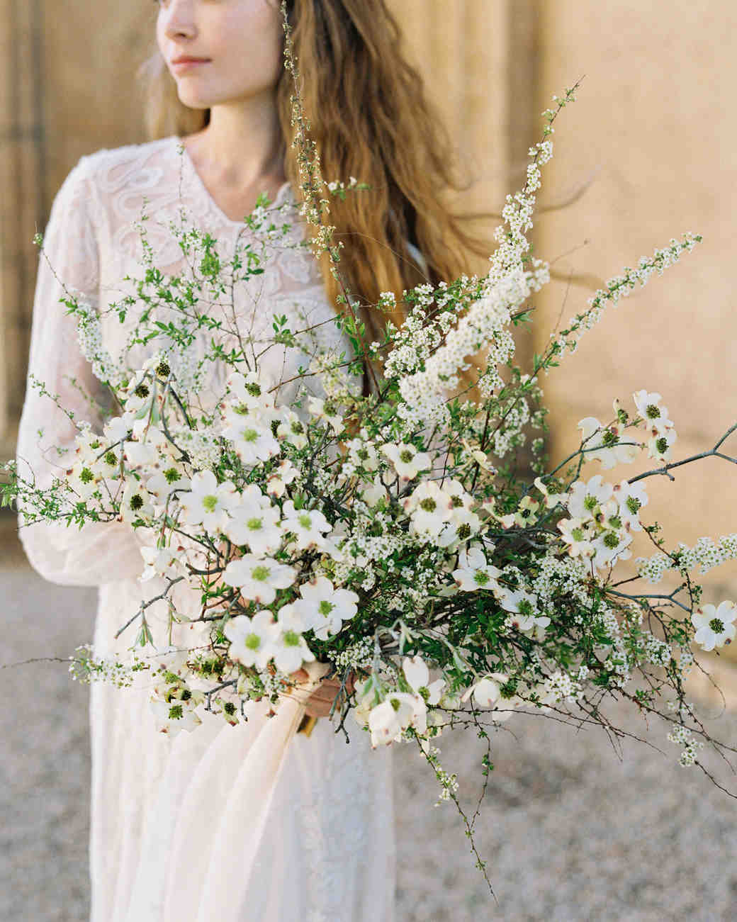 bride with dogwood branch bouquet