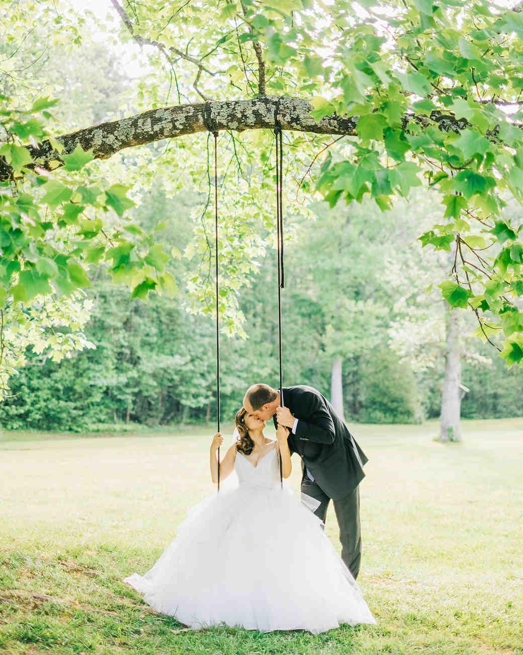 elizabeth jake georgia wedding couple sitting on swing kissing