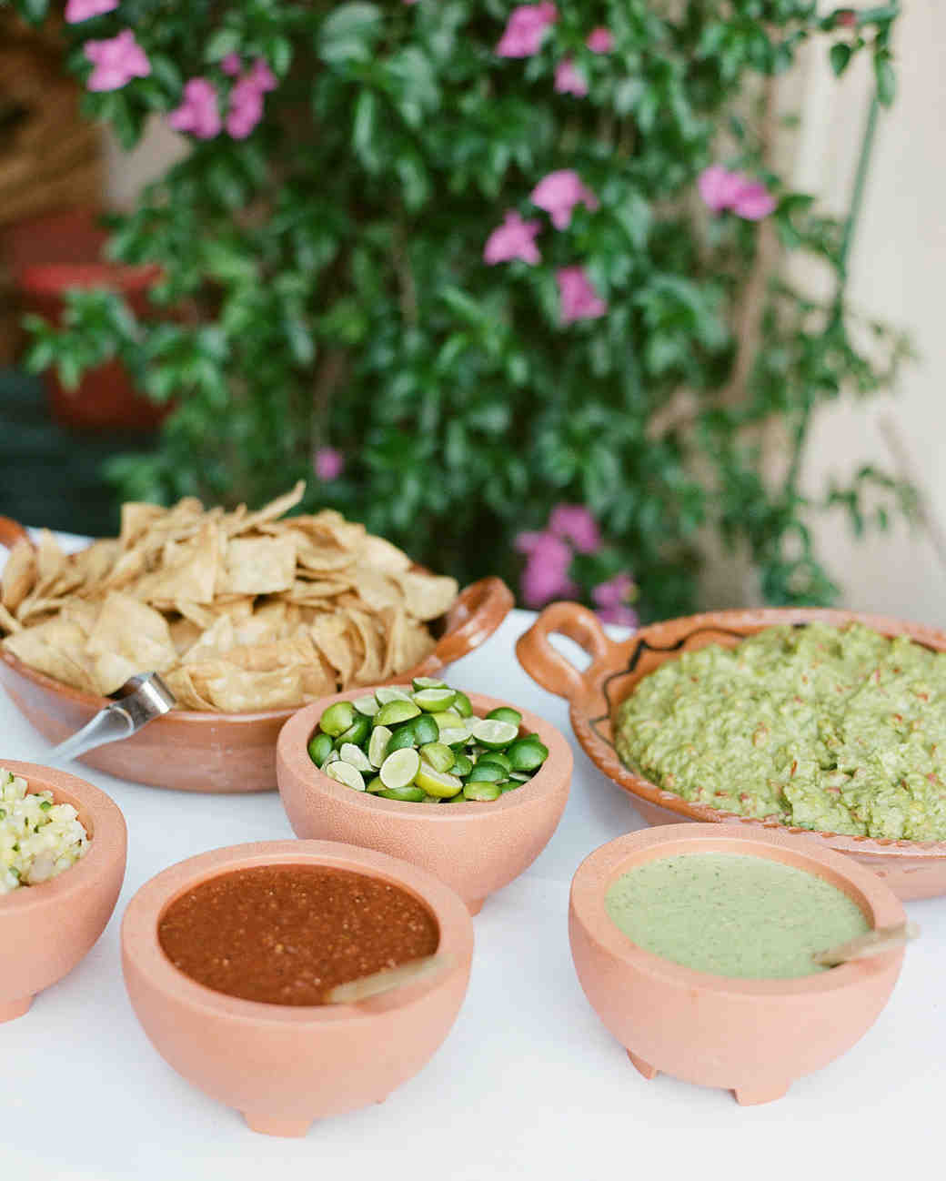 table with chips and salsa and guacamole