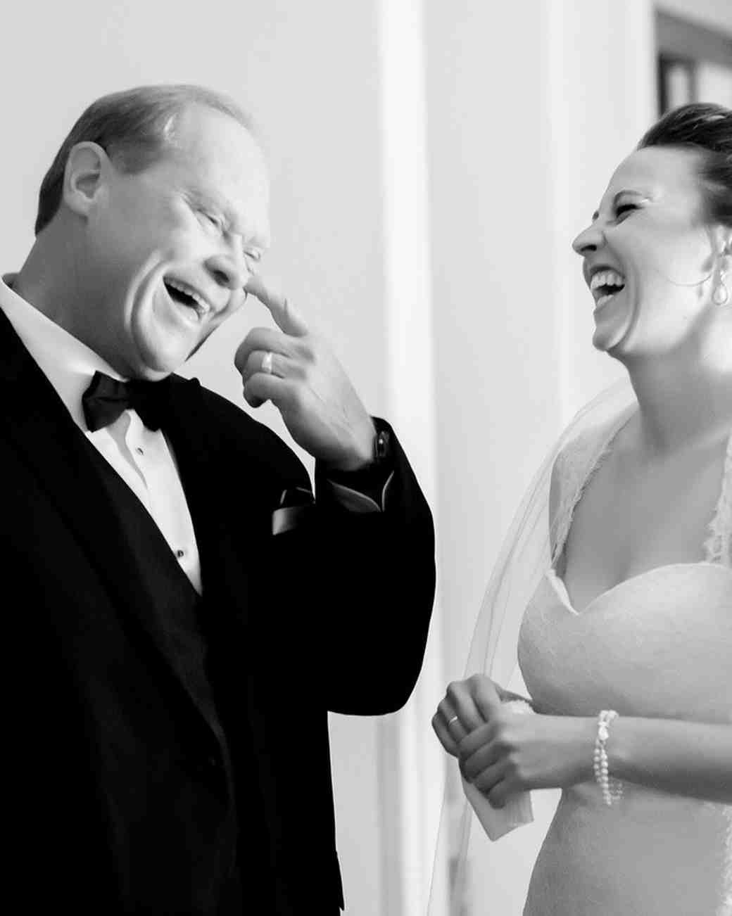 father daughter wedding moment wiping tear laughter