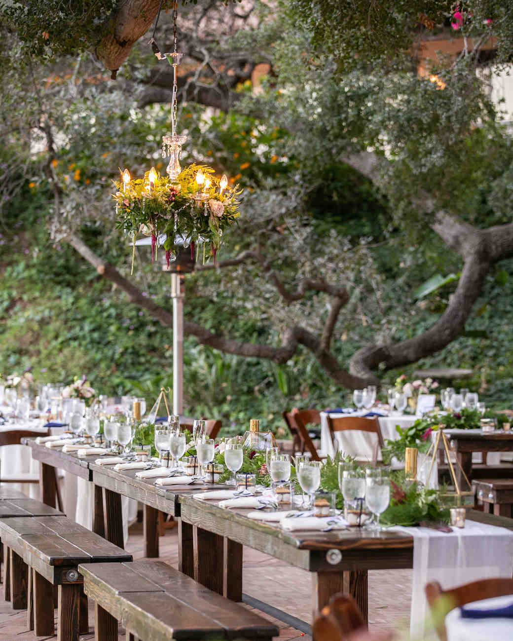 small hanging outdoor chandelier with greenery accents