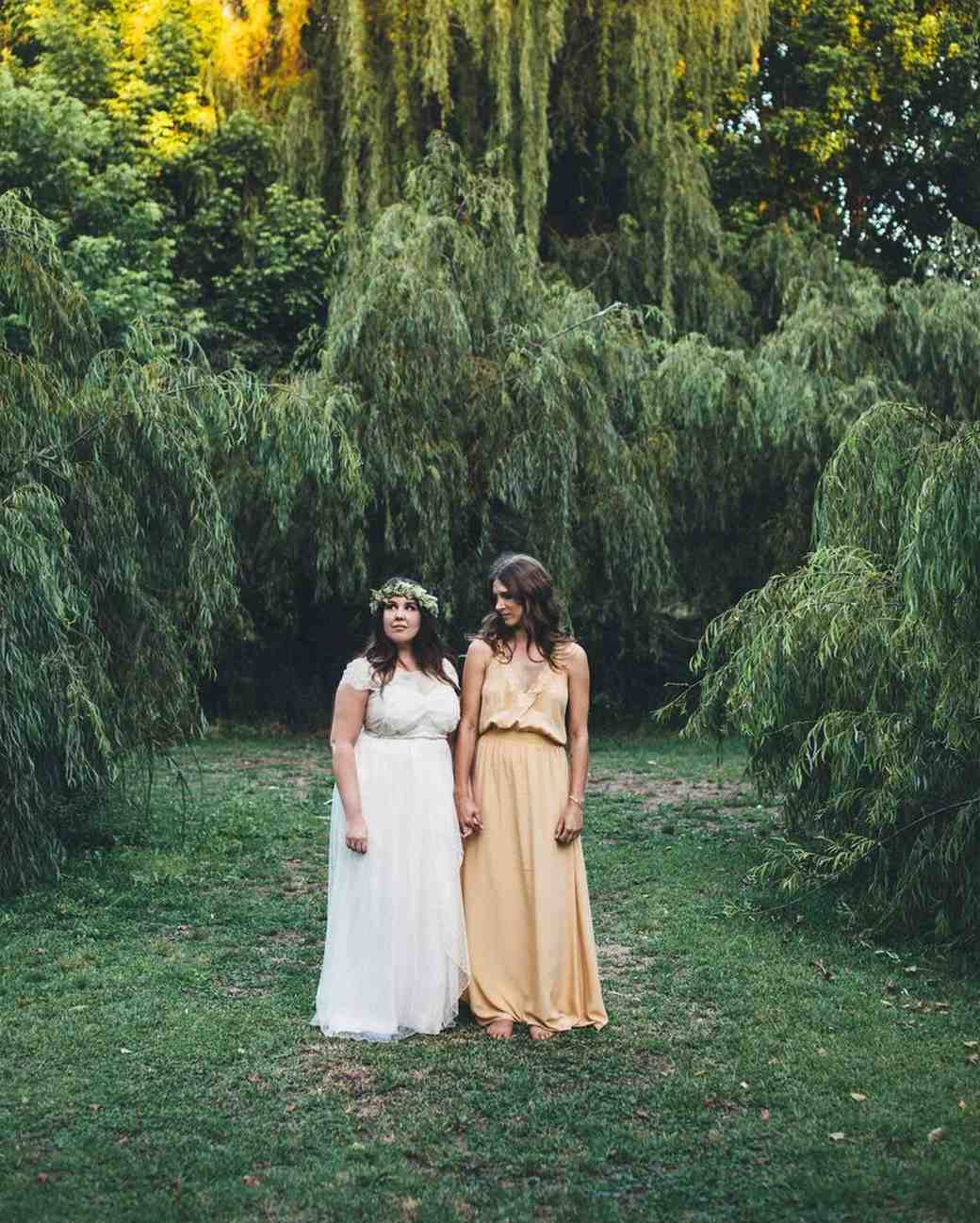 same-sex brides white yellow wedding dresses