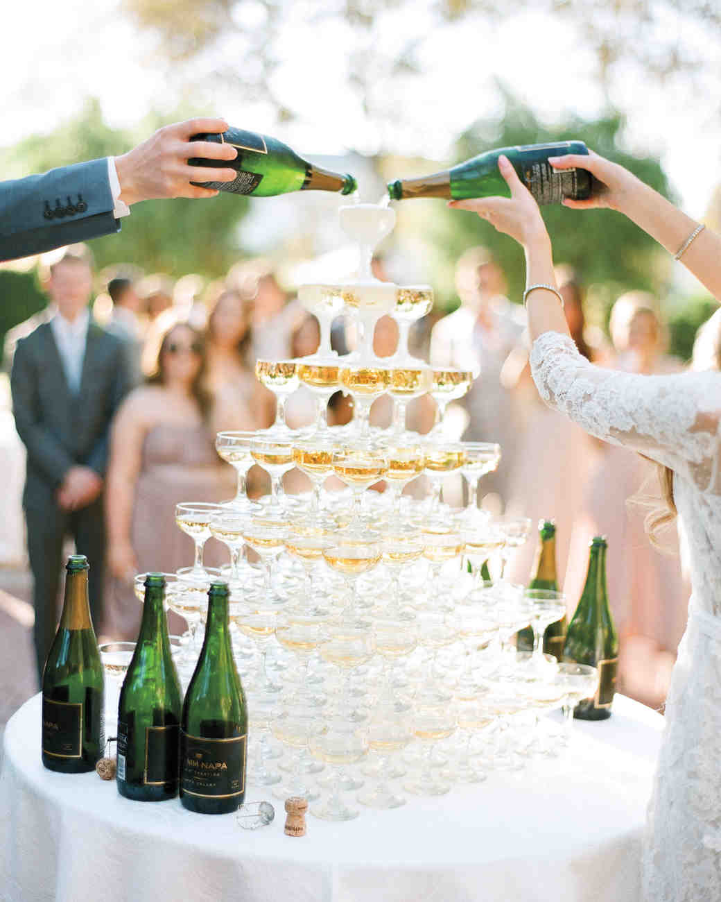 Bride and Groom Filling Champagne Tower