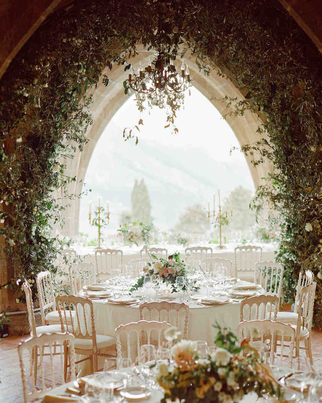 lisa greg italy wedding reception table chairs window view arch