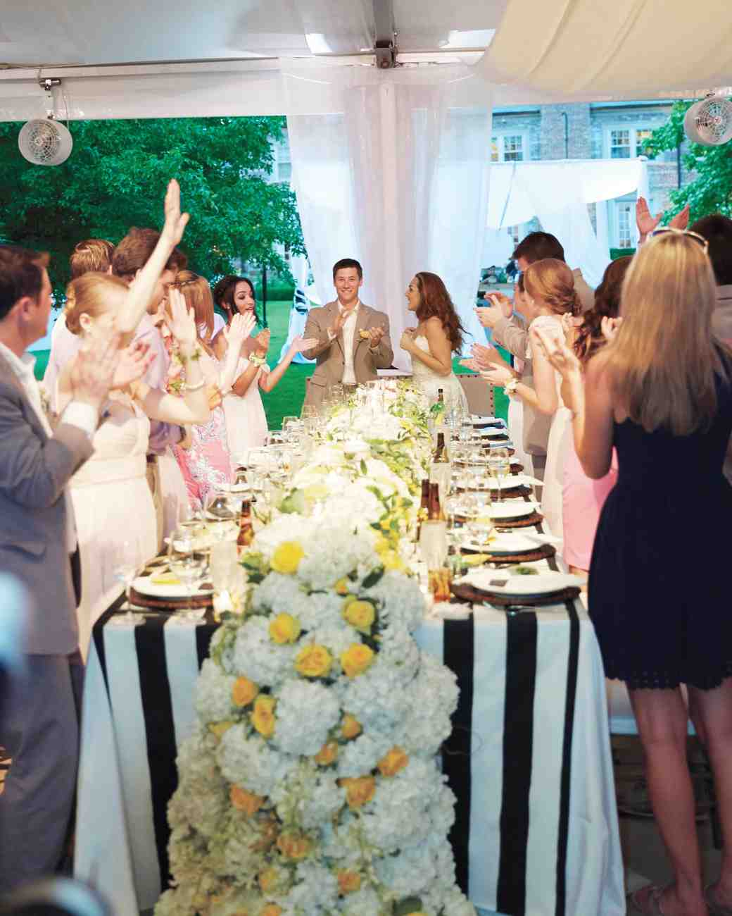 merin-ryan-real-wedding-reception-guests-cheering.jpg