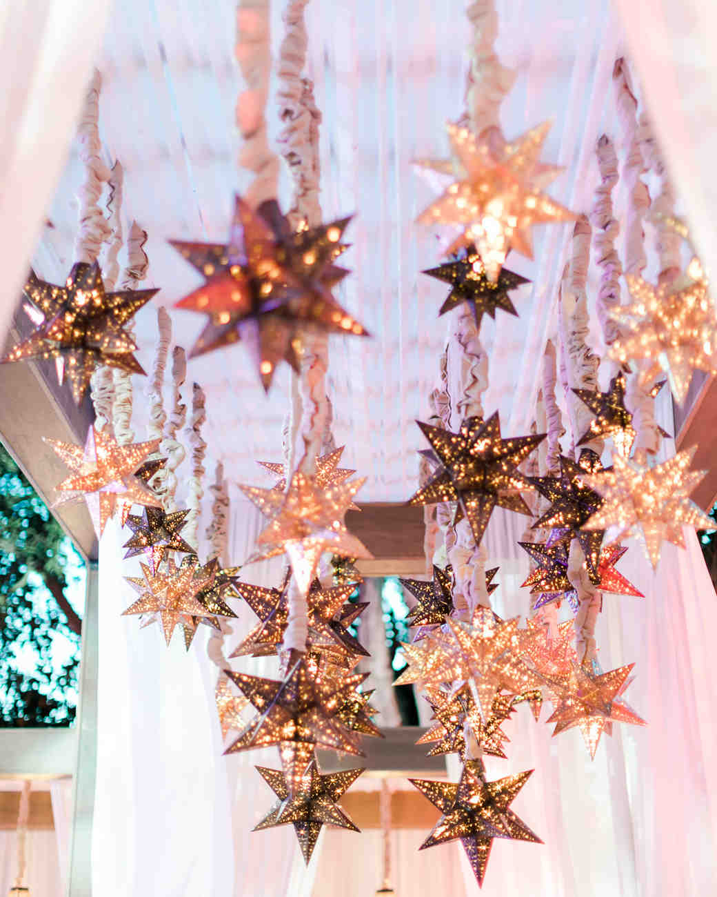 hanging copper colored star shaped lanterns