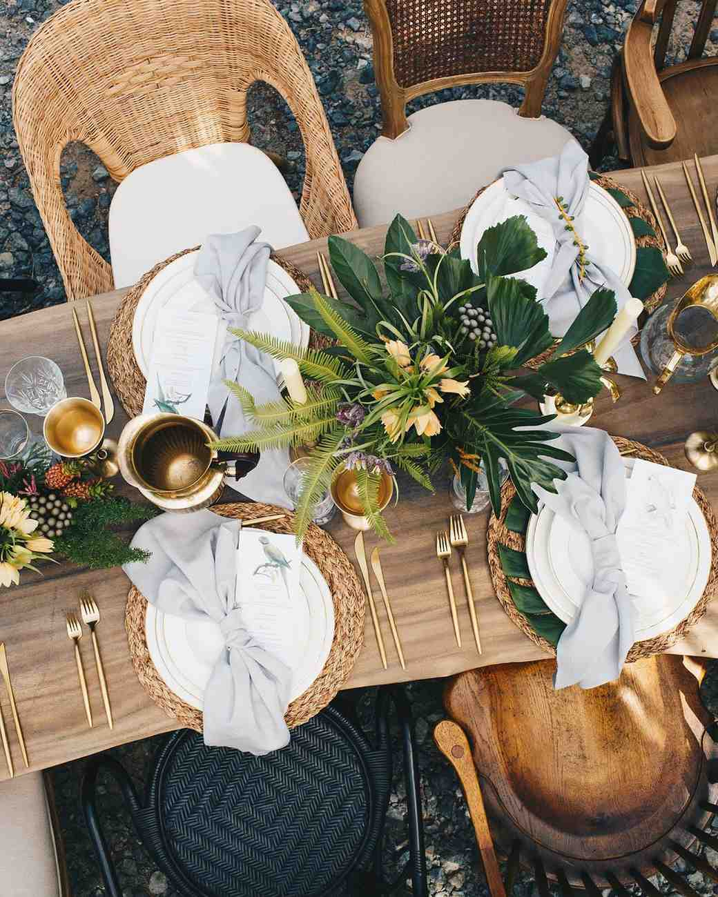 tablescape with rattan accents and tropical floral arrangements