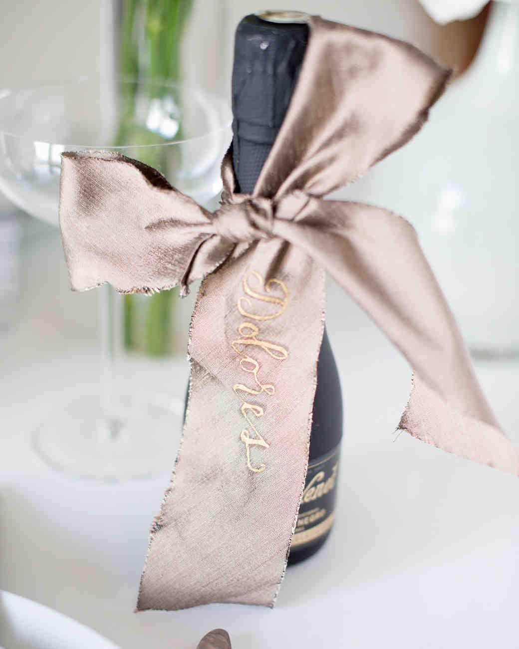 ribbon wedding ideas ribbon tied around mini champagne bottle