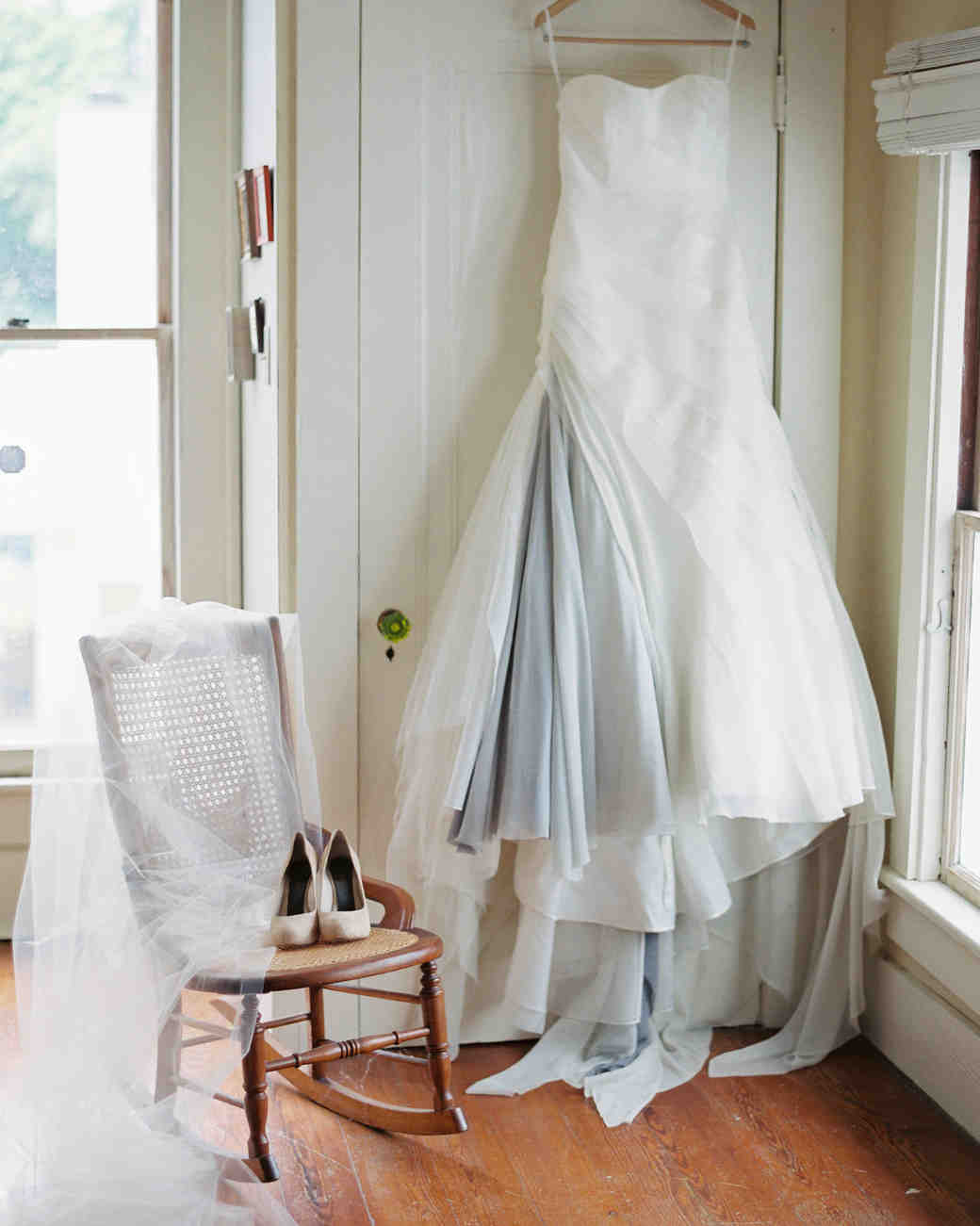 Wedding Gown Hanging in Room