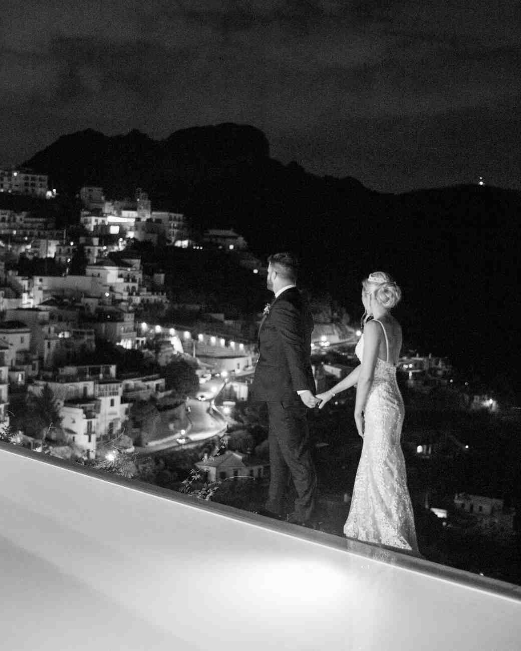 allie and joe italy wedding couple holding hands and overlooking view