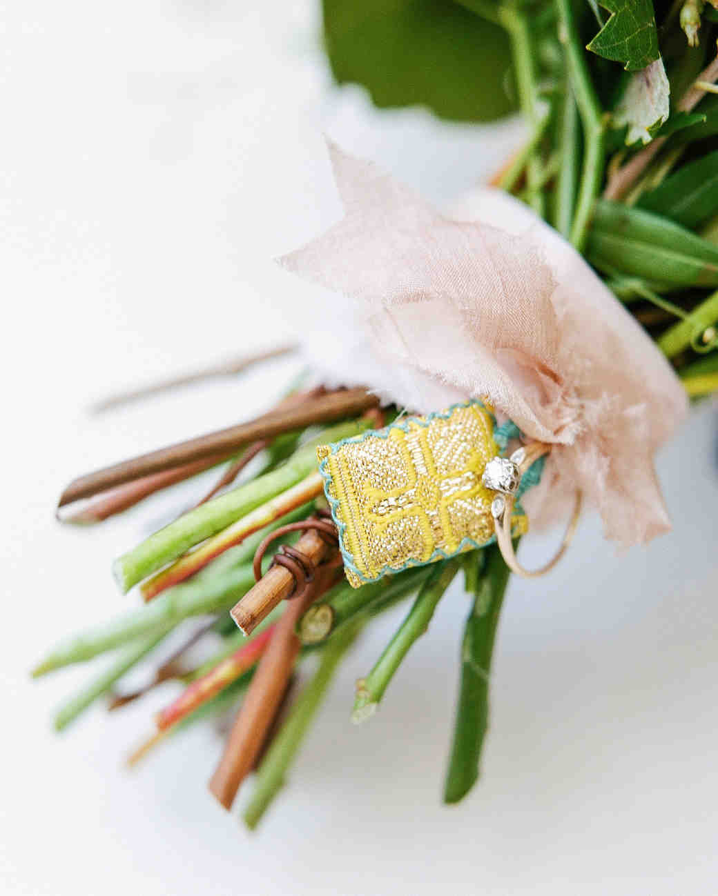 cristina chris wedding ring charm on bouquet