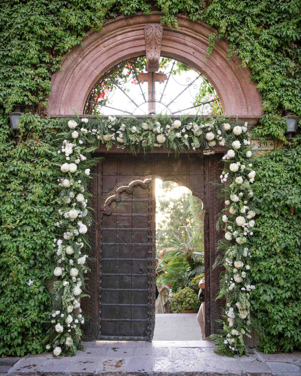 wedding entrance through ivy-covered door