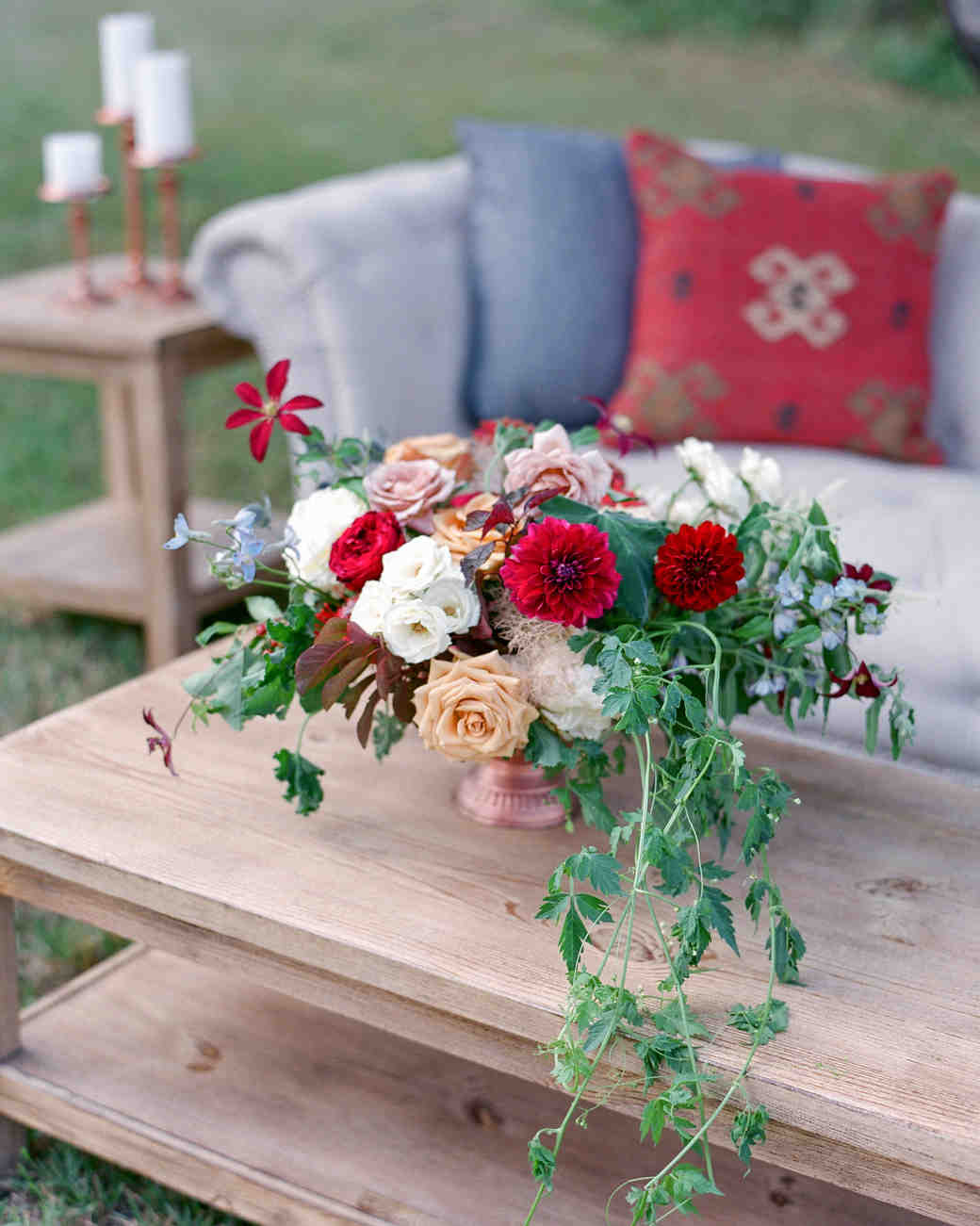 wedding lounge area flowers couch pillows