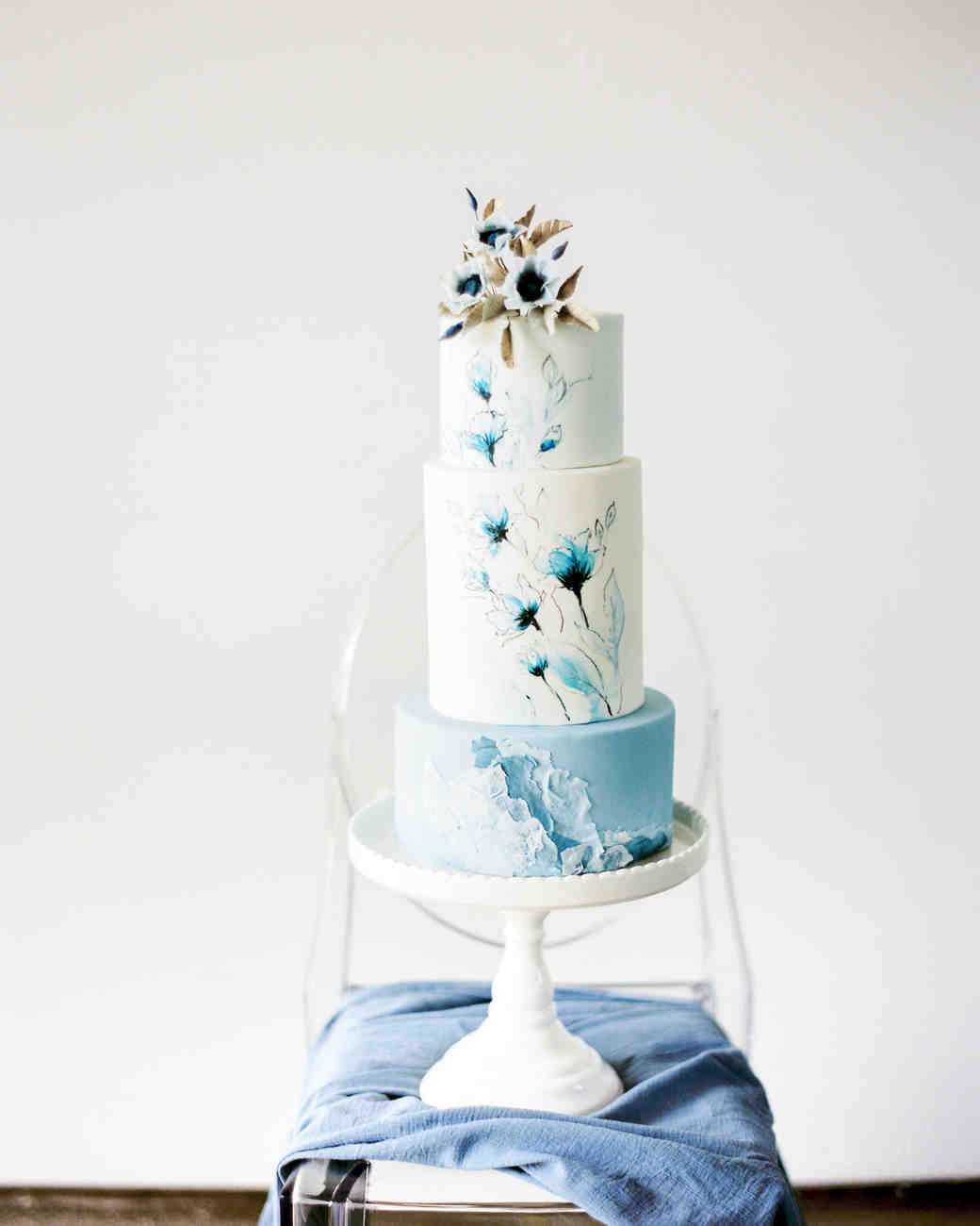 f7fb5e90d9f blue and white wedding cake with flowers