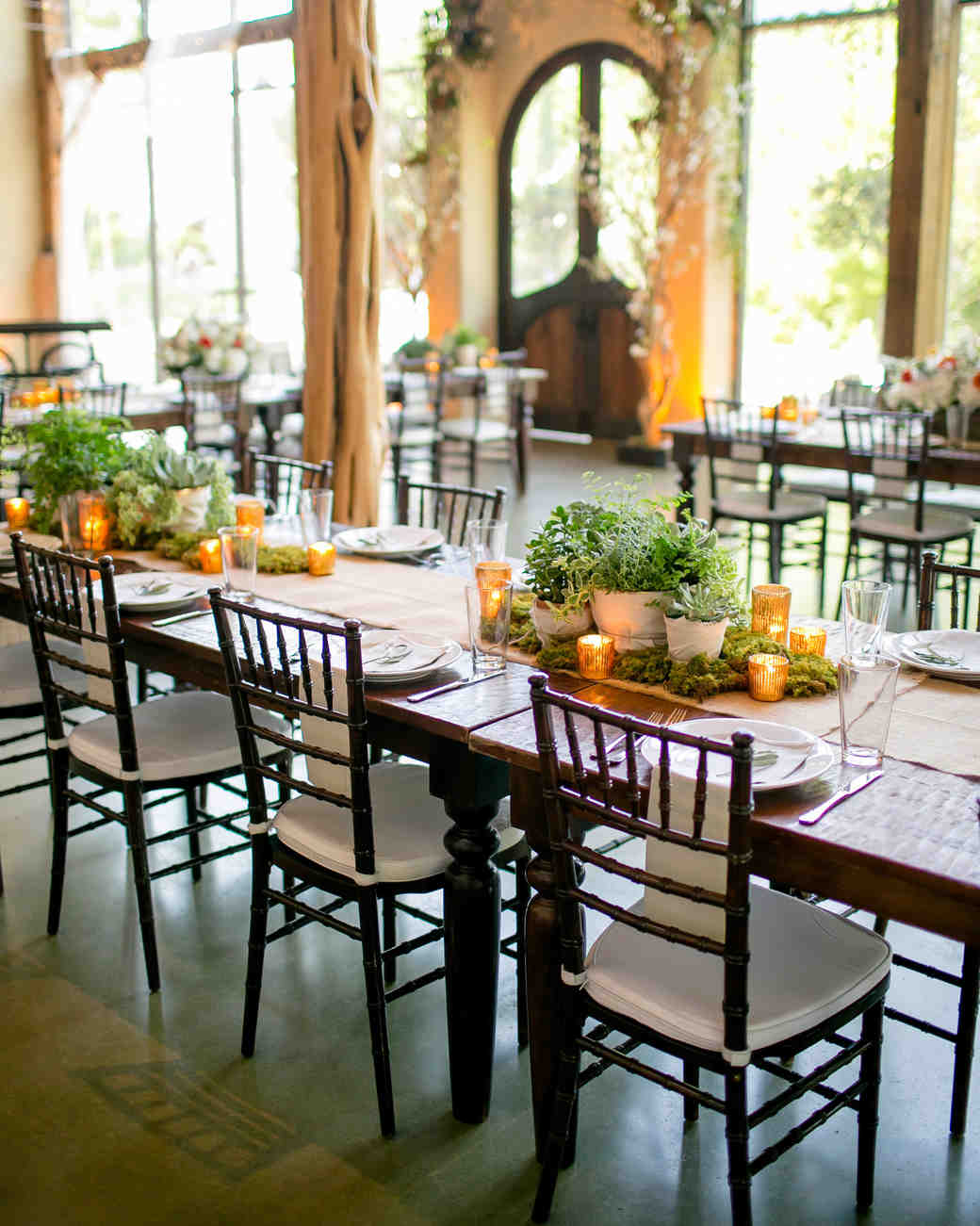 table setting with herb centerpieces and small candles