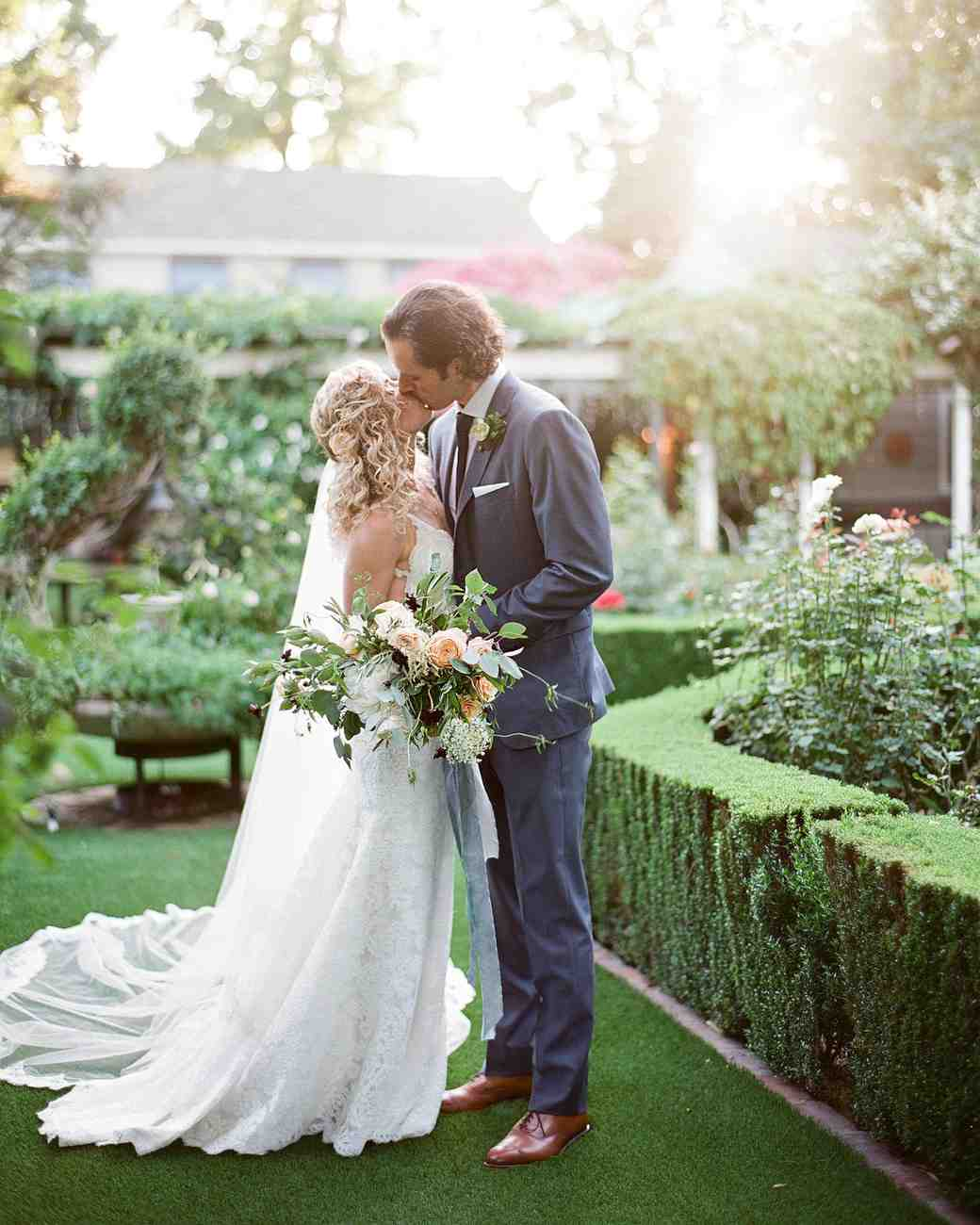 bride and grooms kiss - The Bridal Garden