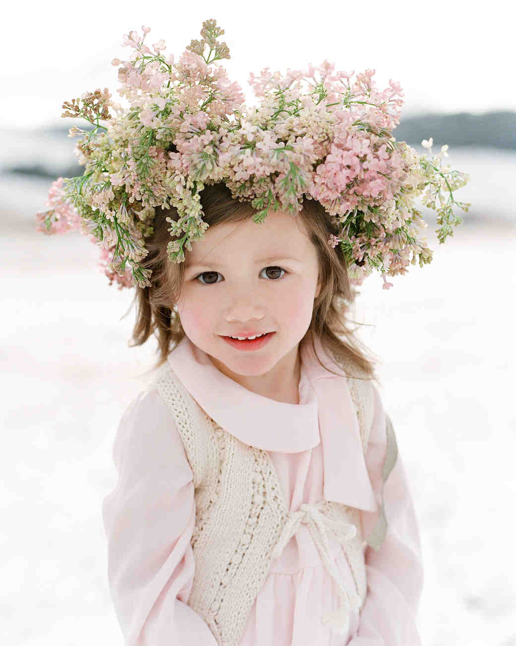 flower girl wearing pink dress and large flower crown