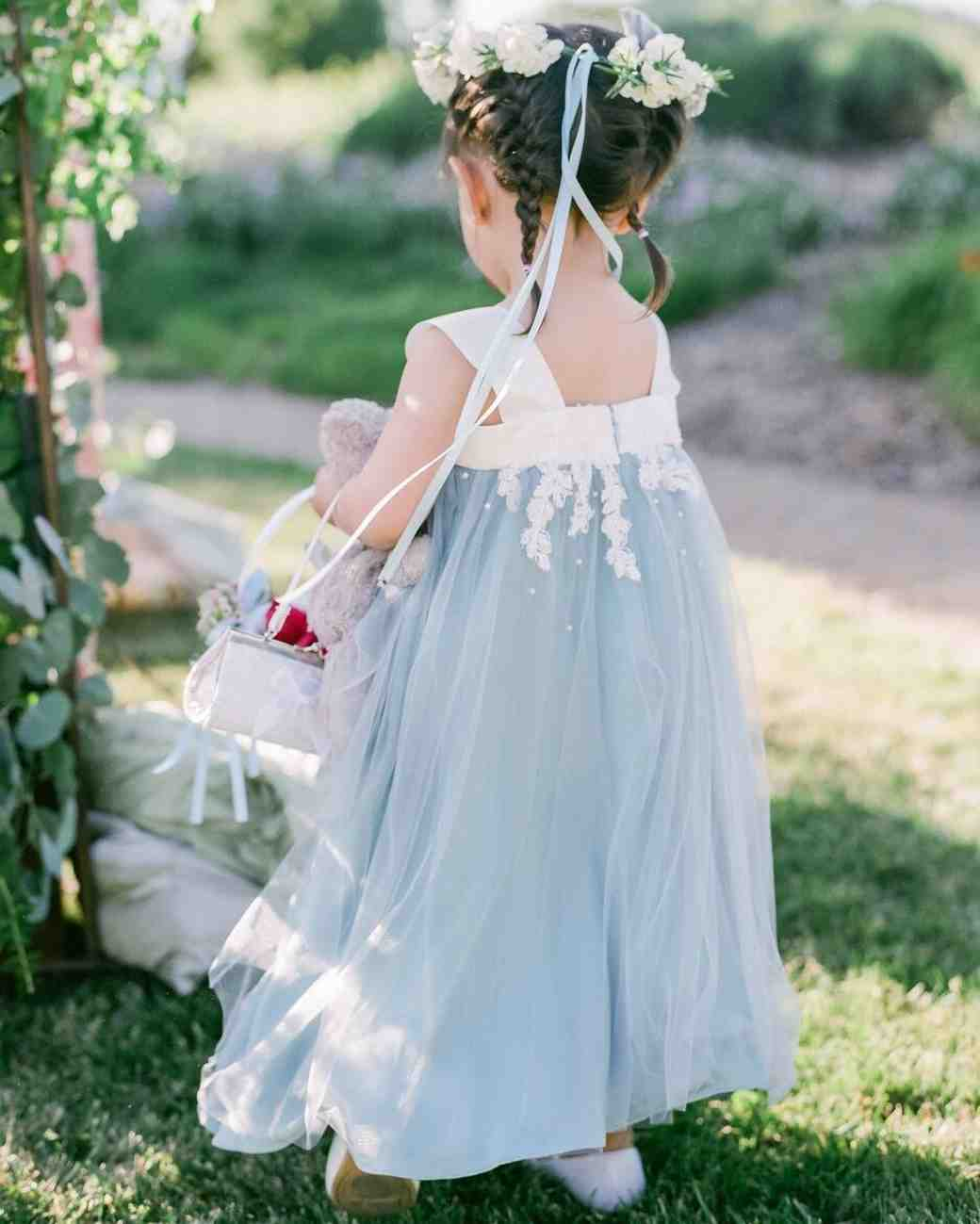 flower girl wearing blue and white dress