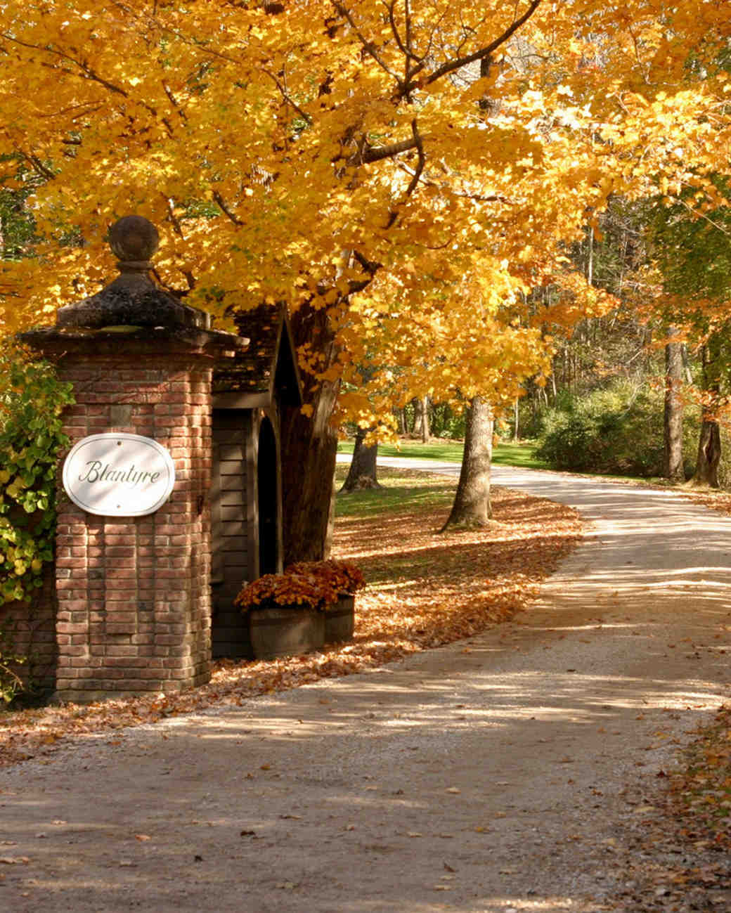 entrance to manor house with fall foliage
