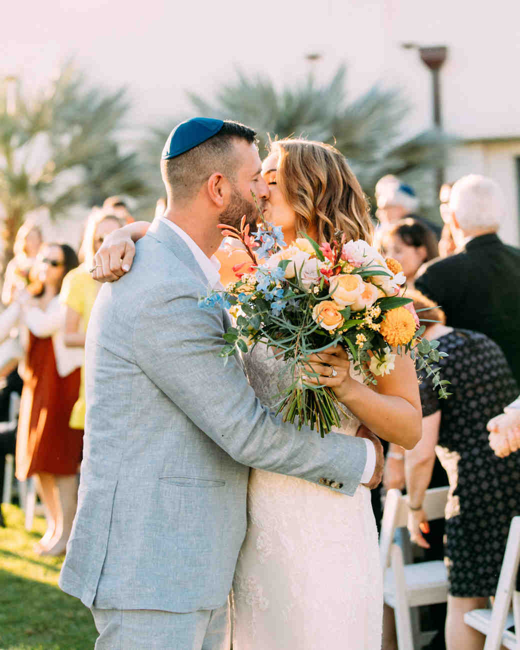 bride groom wedding kiss wearing blue yarmulke