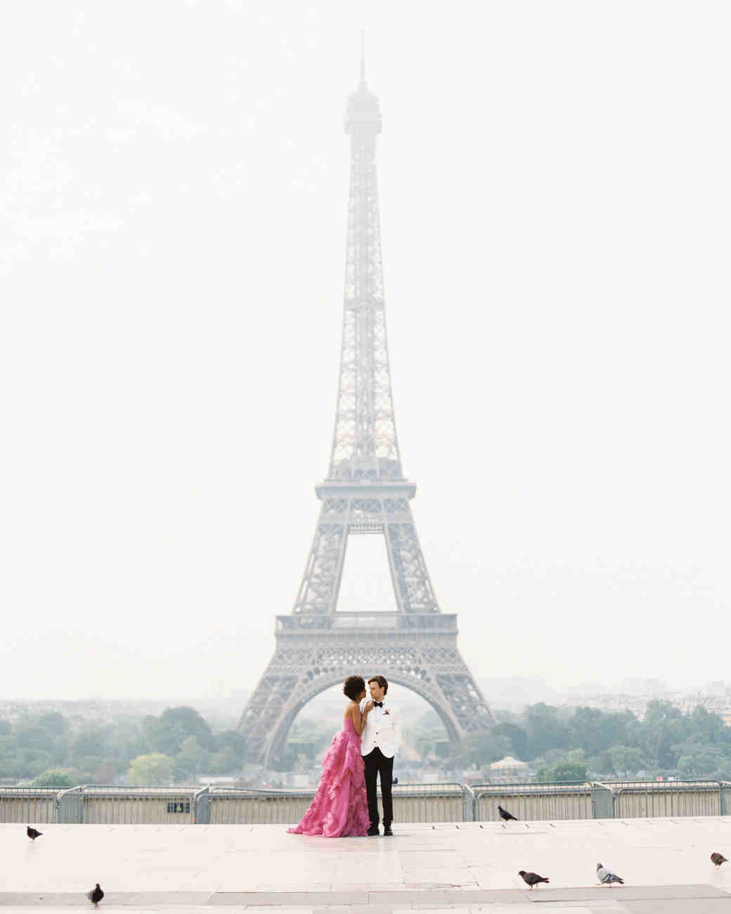 couple standing in front of eiffel tower