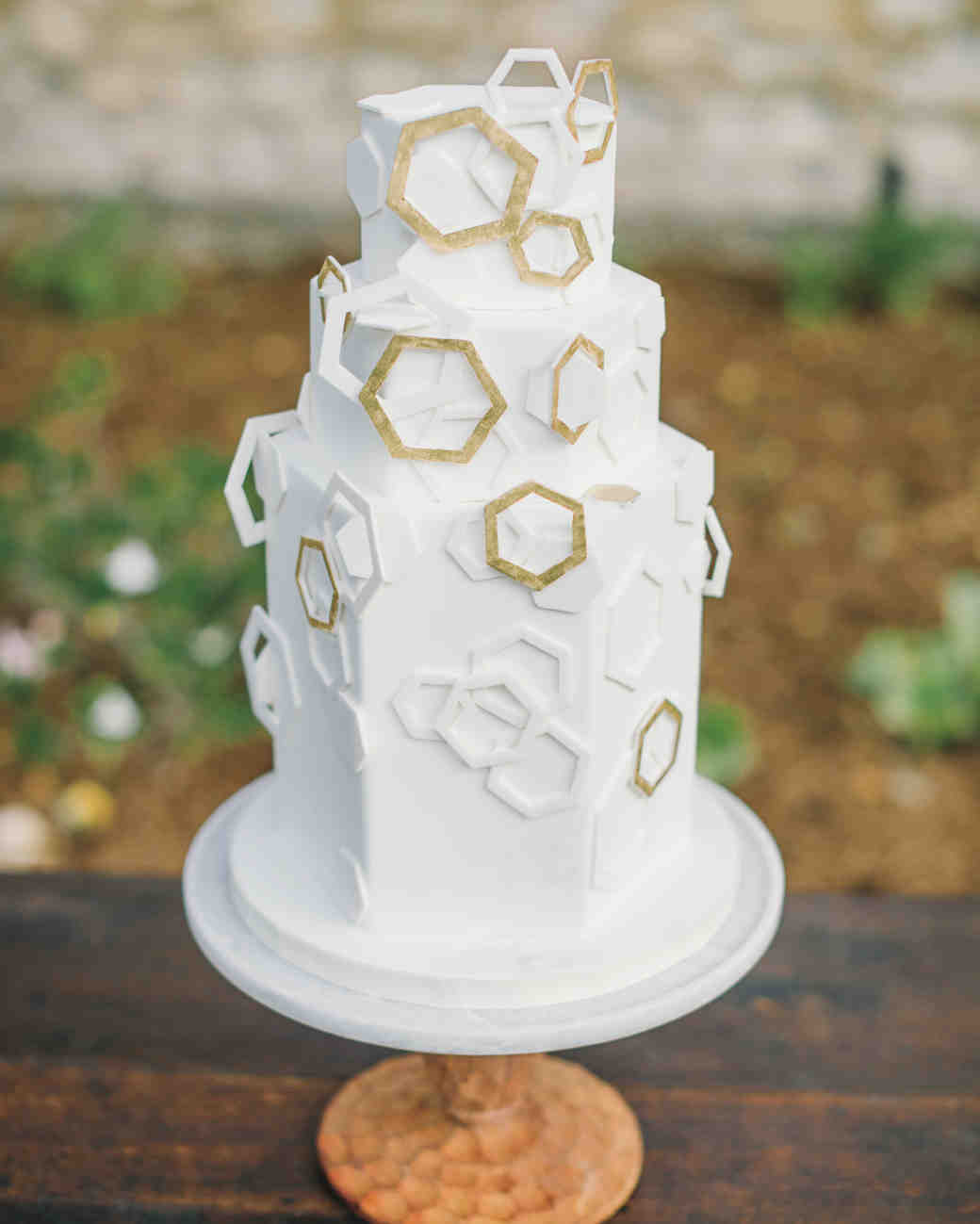 Geometric Three-Tiered White Wedding Cake with Gold and White Fondant Hexagons